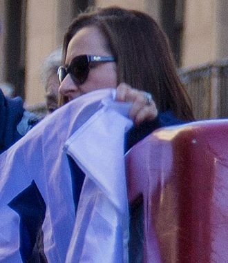 Laura Ricketts - Ricketts holding a Cubs Win Flag during the 2016 World Series victory parade