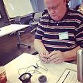 Daniel Schultz uses a bolt to make a DIY amplified guiro - IMPACT 2014 @ NYU Steinhardt (by Ethan Hein).jpg
