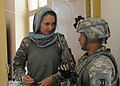 Defense.gov News Photo 101123-F-3959E-171 - U.S. Navy Cmdr. Karen Griffith left executive officer of the Nuristan Provincial Reconstruction Team updates Sgt. Keith Radcliffe a Provincial.jpg