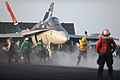 Defense.gov News Photo 110802-N-YZ751-405 - U.S. Navy sailors prepare to launch an F A-18C Hornet aircraft assigned to Strike Fighter Squadron 15 aboard the aircraft carrier USS George H.W.jpg