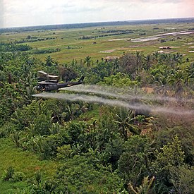 U.S. helicopter spraying chemical defoliants in the Mekong Delta, South Vietnam.