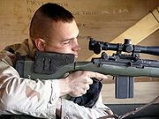 Marine sniper using the USMC Designated Marksman Rifle (DMR)