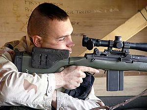 Designated marksman - US Marine Corps Designated Marksman, armed with the Designated Marksman Rifle (DMR), derived from an M14 rifle with a telescopic sight.