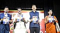 Dharmendra Pradhan and the Minister of State for Information & Broadcasting, Col. Rajyavardhan Singh Rathore releasing the radio magazine 'Vetar Vanee', at the valedictory function of the International Radio Fair.jpg