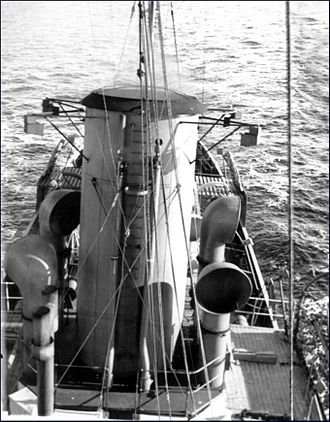 Diffused lighting camouflage - HMCS ''Kamloops'' with diffused lighting camouflage fittings on struts around the funnel, September 1941