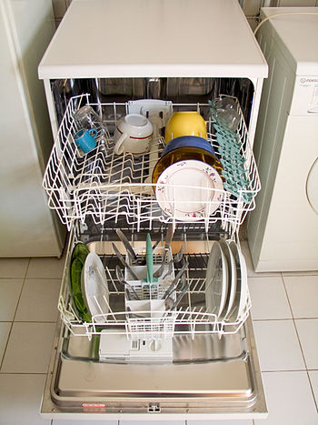 Dishwasher, open and loaded with dishes