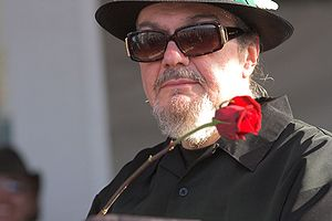 Dr. John in a wide-brimmed hat and sunglasses