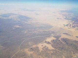 national park in the Sahara Desert in Algeria, including prehistoric cave art