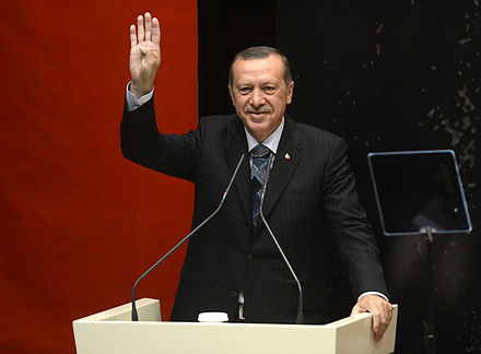 Erdogan performing the Rabaa gesture (which is used by Muslim Brotherhood supporters in Egypt protesting against the post-Brotherhood authorities) Erdogan gesturing Rabia.jpg
