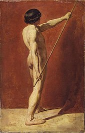 Nude man holding a long pole