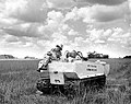 Everglades National Park Ranger Erwin C. Winte and Dr. Frank C. Craighead in a catapiller vehicle with fire-fighting equipment. (26b18d848ce84a1997938db297194508).jpg
