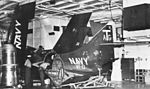 F9F-8 of VF-13 in hangar of USS Bennington (CVA-20) c1956.jpg