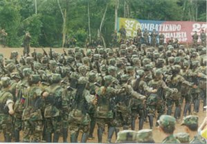 Revolutionary Armed Forces of Colombia - FARC guerrillas marching in formation during the Caguan peace talks (1998–2002)