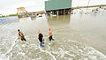 FEMA - 38332 - Local Residents walk thorugh Texas floodwaters.jpg