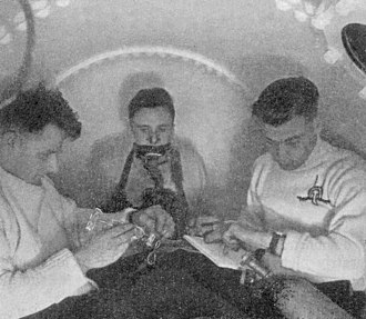 Physiology of underwater diving - In 1942–43 the UK Government carried out extensive testing for oxygen toxicity in divers. The chamber is pressurised with air to 3.7 bar. The subject in the centre is breathing 100% oxygen from a mask.