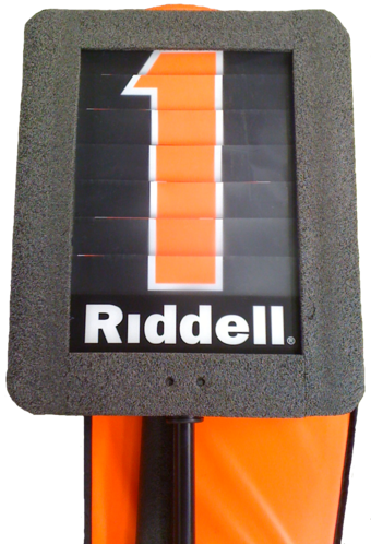 A modern down indicator box is mounted on a pole and is used to mark the current line of scrimmage. The number on the marker is changed using a dial. First down marker.png