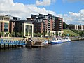 Flow tidemill artwork and river cruise boats moored on the Tyne (geograph 3068125).jpg