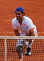 Fognini at the net (8332993235).jpg