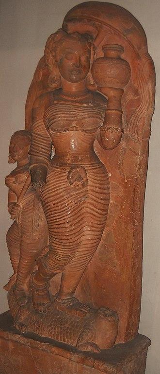 Kumbha - The goddess Ganga shown with a kumbha (a full vase)