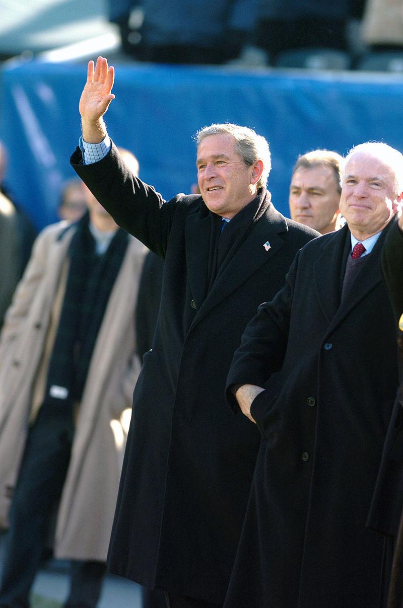 George W. Bush and John McCain at the Navy goal line 2004.jpg