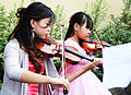 Girls playing violin at a wedding ceremony.jpg