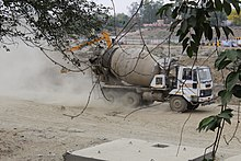 Gomti riverfront; heavy machinery over the riverbed