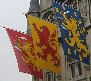 Coat of arms of the Netherlands - The banners of the Dutch Republic, the County of Holland and the Kingdom of the Netherlands, hung from the town Hall in Gouda.