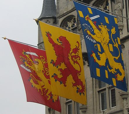 The banners of the Dutch Republic, the County of Holland and the Kingdom of the Netherlands, hung from the town Hall in Gouda. Gouda Arms of Dutch republic County Holland Kingdom The Netherlands.JPG