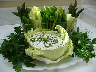 Green goddess dressing salad dressing, typically containing mayonnaise, sour cream, chervil, chives, anchovy, tarragon, lemon juice, and pepper