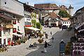 Gruyere castle over the village square.jpg