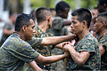 Guatemalan marines participate in a combat conditioning exchange with U.S. Marines assigned to a landing attack subsequent operations team as part of U.S. Marine Corps Martial Arts Program training during 140819-N-XQ474-111.jpg