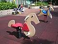 HK Sunday Wan Chai Park Playground Spring Horse.JPG