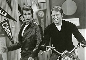 Ron Howard - Richie (Ron Howard) takes a turn on Fonzie's motorcycle in a scene from Happy Days