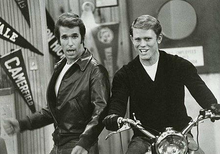 Richie (Ron Howard) takes a turn on Fonzie's motorcycle