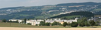 Schwarzenberg, Saxony - View from the road to Jägerhaus: In the foreground the residential area of Heide, behind it in the middle of the picture the residential area of Sonnenleithe, on the right edge of the picture Beierfeld, on the left edge of the picture Bernsbach, on the horizon to the right, the Spiegelwald