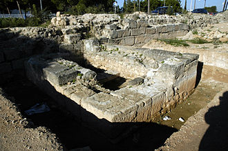 Hexamilion wall - A preserved portion of the wall with the base of a tower.