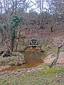 Highland Water stream emerges from culvert beneath A31 at Ocknell - geograph.org.uk - 711147.jpg