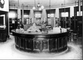Reference desk - Librarian, Ballard Carnegie Library, Seattle, Washington ca. 1907