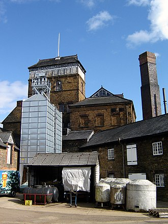 Hook Norton Brewery - From the back, it becomes clear that this is still a commercial brewery. (April 2006)