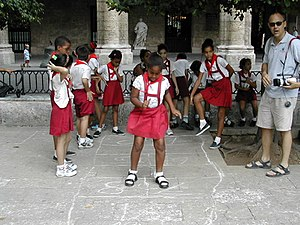"""Hopscotch - Primary schoolchildren hopscotching in Cuba, where the game is known as """"pon"""""""