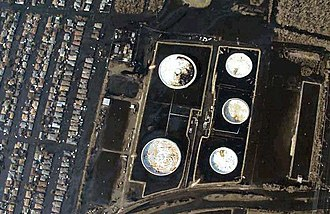 New Orleans metropolitan area - Hurricane Katrina aerial photo of oil spill in Chalmette, Louisiana, showing oil slick on streets (September 2005)