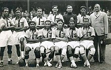 ce017428894 Indian team at 1948 Olympics, T. Ao at the centre of first row, goal scorer  S. Raman next to Ao and coach Balaidas Chatterjee to the extreme right.