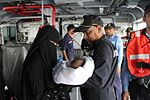 Indian Navy officers transfer a kid from boat (02).JPG