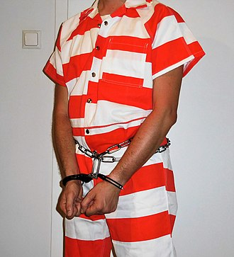 Badge of shame - Inmate in orange and white striped jumpsuit