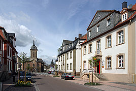The Schlossstrasse in the central district of Bad Arolsen - in the far west the Kirchplatz with church