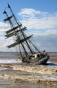 The tall ship Irving Johnson, lying hard aground