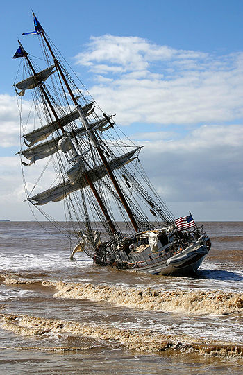The tall ship Irving Johnson lies hard aground...