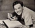 John Garfield reading, 1944.jpg