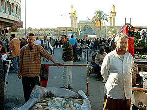 Kadhimiya - Souq in Al-Kāẓimiyyah with the shrine in the background.