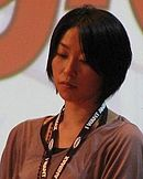 Serious-looking Japanese woman with short black hair